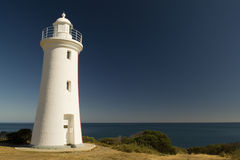 White Light House. Mersey Bluff lighthouse looks out over a dark blue ocean at Devenport, Tasmania, Australia - with copy space royalty free stock image