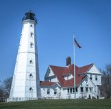White light house at Lake Park in Milwaukee. Beautiful white lighthouse against blue sky Stock Photo