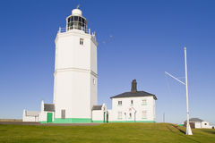 White light house on a sunny day Royalty Free Stock Images