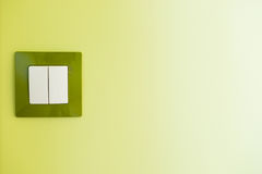 White light switch on a green wall Stock Photos