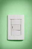 White Light Switch On Green Wall. Royalty Free Stock Images