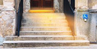 Light from sky . Religion background . White light under old door . Staircase going up to the light royalty free stock photo