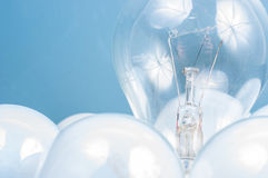 White lightbulb closeup in blue Stock Image