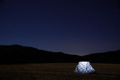 White Lighted Tent during Night Time Stock Images