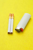A white lighter with two cigarettes Stock Image