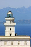 White lighthouse. Of Capo Testa in north Sardinia, with Corse view beyond the sea Stock Photo