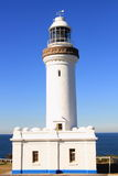 White lighthouse at blue sky Royalty Free Stock Photography