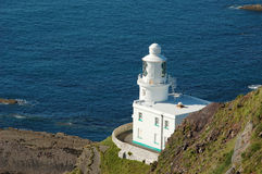 The white lighthouse. Above the cliffs in Cornwall royalty free stock photography