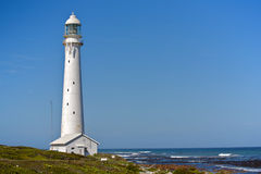 White Lighthouse. A tall white lighthouse facing the Indian Ocean, on a South African beach Royalty Free Stock Image