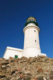 White lighthouse. On the background of blue sky stock photography