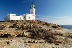 White lighthouse. On the background of blue sky royalty free stock images
