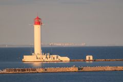 White lighthouse on  against the background stock image