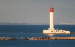 White lighthouse on  against the background stock photography