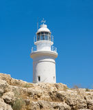 White lighthouse against a blue sky. View of the lighthouse from the bottom point Royalty Free Stock Photography