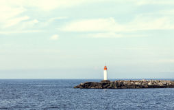 Free White Lighthouse And Stone Pier Royalty Free Stock Photo - 48967015