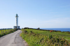 White lighthouse in Asturias, Spain Stock Photos