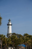 White Lighthouse Beyond Park Royalty Free Stock Photos