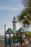 White Lighthouse Beyond Playground Stock Photos