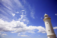 White lighthouse with blue sky Royalty Free Stock Image