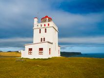 White lighthouse. On the cape Dyrholaey, Southern Iceland stock photography