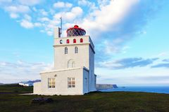 White lighthouse at Cape Dyrholaey. View on white lighthouse at Cape Dyrholaey, Iceland stock images
