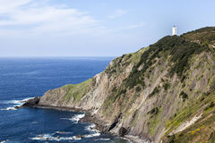 White lighthouse on the cliff Stock Photography