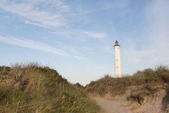 White lighthouse dunes royalty free stock image