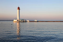 White lighthouse in the evening Royalty Free Stock Photography