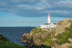 White lighthouse at Fanad Head, Donegal, Ireland. White lighthouse at Fanad Head, North Coast of Donegal, Ireland Royalty Free Stock Photos