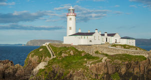 White lighthouse at Fanad Head, Donegal, Ireland. White lighthouse at Fanad Head, North Coast of Donegal, Ireland at the sunset Royalty Free Stock Images