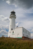 White lighthouse on Flamborough Head in England. Stock Photos