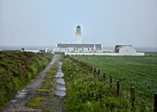 White Lighthouse in fog Royalty Free Stock Photography