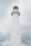 White lighthouse in front of storm clouds Royalty Free Stock Photography
