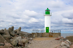 White lighthouse with green details Royalty Free Stock Photos