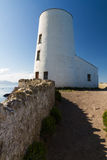 White lighthouse on Llanddwyn Island, Anglesey Stock Photo