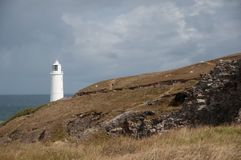 White light on north Cornwall coast. White lighthouse located on the north coast of Cornwall, UK stock photography