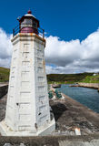 The white lighthouse of Lybster harbor, Scotland. Stock Photography