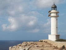 White lighthouse in the mediterranean coast Royalty Free Stock Images