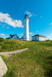 White lighthouse in nature, landscape of Denmark Stock Photos