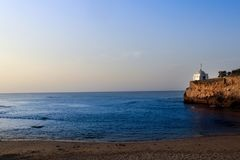 White Lighthouse Near Sea Under Blue Sky Stock Photography
