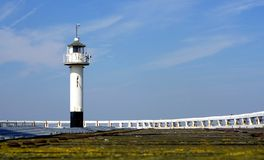 White lighthouse, North Sea coast Royalty Free Stock Images