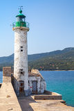 White lighthouse, Propriano, Corsica, France. White lighthouse tower with green top. Entrance to Propriano port, Corsica island, France Royalty Free Stock Image
