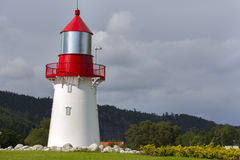 White lighthouse with red roof Stock Photos