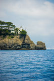 White lighthouse on the rock. Portofino Stock Images