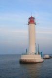 White lighthouse; the sea and coastline. Odessa Stock Image