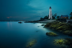 White lighthouse by the shores of New Haven at night Stock Image