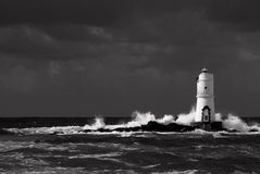 White lighthouse. Lighthouse in the south of Sardinia Royalty Free Stock Images