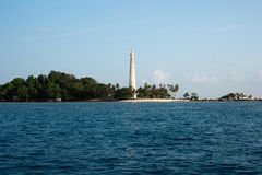 White lighthouse standing on island beach in Belitung, Indonesia. Stock Photo