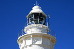White Lighthouse Top Blue Sky. White Lighthouse against a Blue Sky in northern Tasmania, Australia stock photos