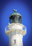 White lighthouse top. White lighthouse, location - Castlepoint, North Island, New Zealand Royalty Free Stock Photos